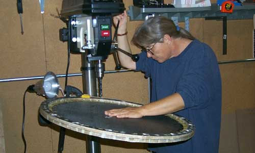 Sue drilling holes in plate